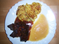 Pot roast beef Sauerbraten with potatoe pancakes and applesauce