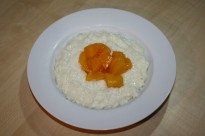 Diced peaches on top of rice pudding