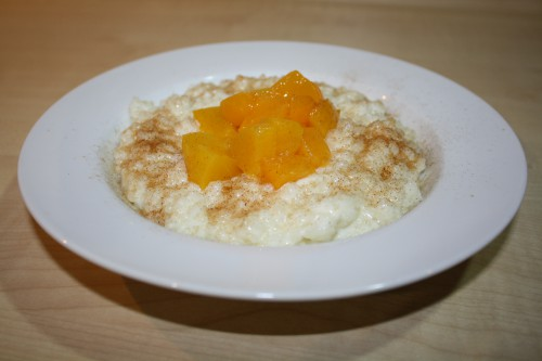 Rice pudding with cinnamon and peaches