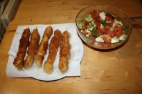 Chicken on a stick with salad